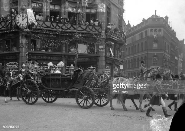 King George V and Queen Mary passing through Ludgate Circus on their drive through London on the day after the Coronation *Damaged Negative*