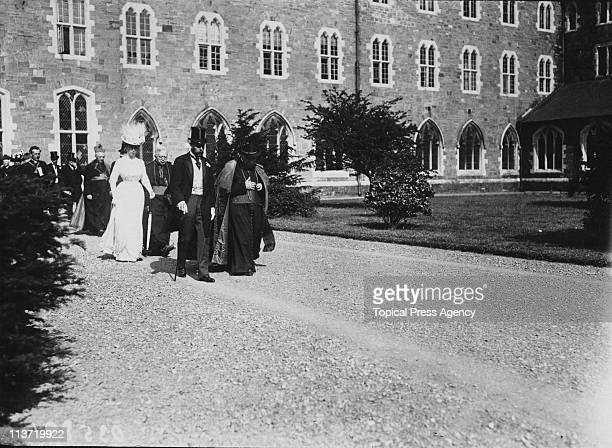 King George V and Queen Mary walking in the grounds of Maynooth College in Maynooth County Kildare during a visit to Ireland July 1911 From left to...