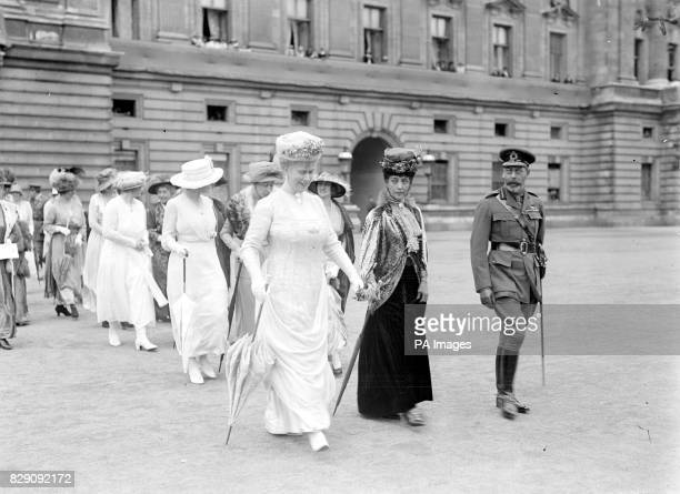 King George V and Queen Mary with Queen Alexandra leave Buckingham Palace for the day to watch the Victory Parade 1919