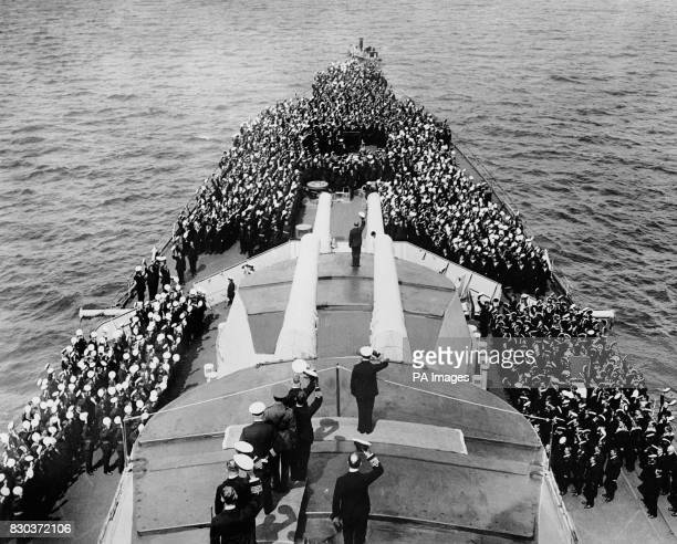 King George V being cheered by the crew of HMS Repulse