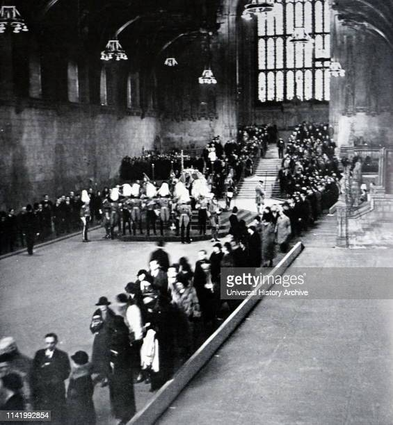 King George V lies in state in Westminster Hall London as crowds pass his coffin Funeral of King George V King of the United Kingdom and the British...