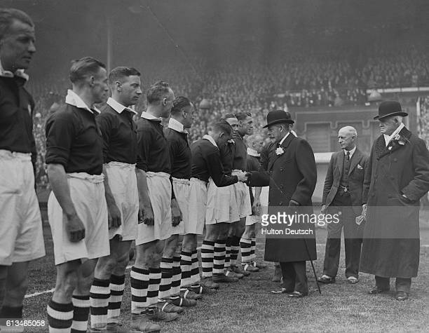 King George V of England shakes hands with the Manchester City soccer team before the kickoff of the Football Association Cup Final at Wembley