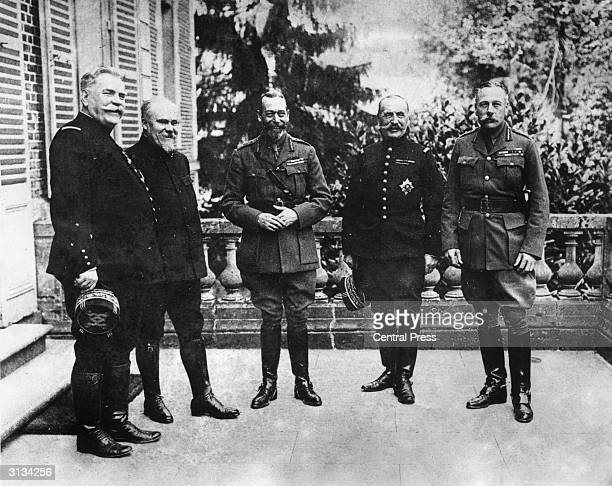 King George V of Great Britain at Beauquesme France with French Field Marshal Joseph Joffre French politician Raymond Poincare French General...