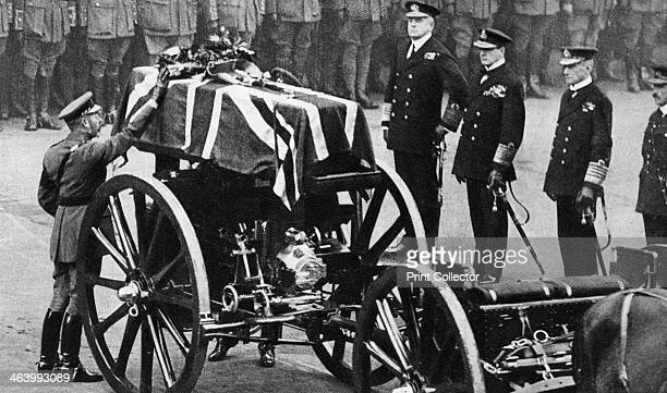 King George V places a wreath on the coffin of an unknown soldier Whitehall London c1930s Illustration from George V and Edward VIII A Royal Souvenir...