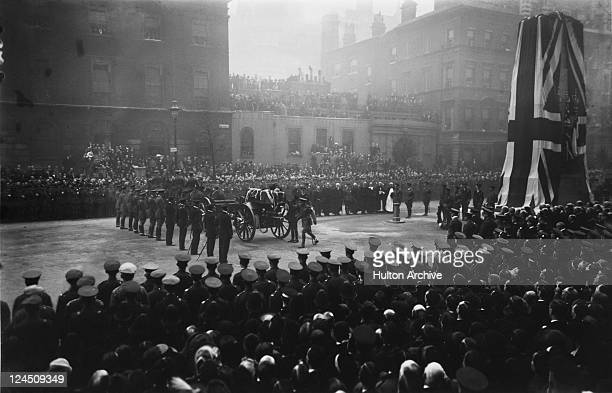 King George V places a wreath on the flag-draped coffin of an unidentified British soldier, London, 11th November 1920. The soldier is to be buried...
