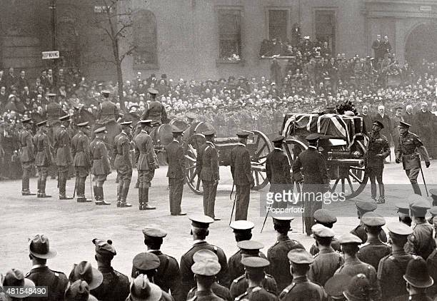 King George V placing a wreath on the coffin of the Unknown Warrior at the Cenotaph in London with admirals and field marshals alongside the gun...