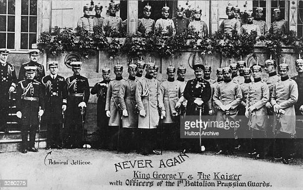 King George V stands with Kaiser Wilhelm II and the officers of the 1st battalion of the Prussian guards The King is dressed in the uniform of the...