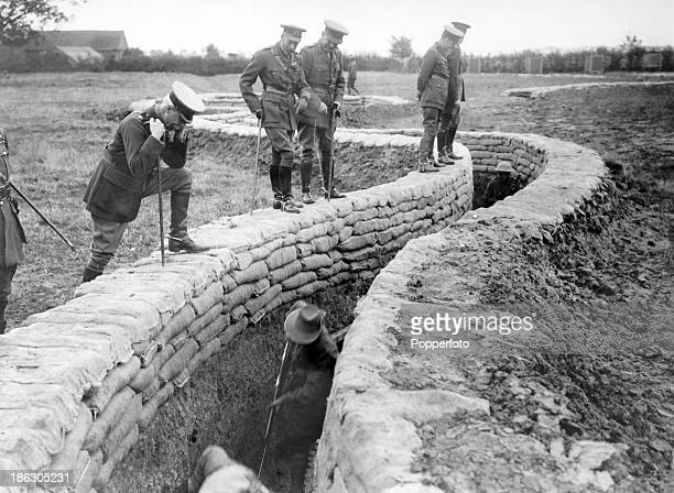 King George V watching Australian troops at drill in the trenches on the Western Front during World War One circa 1918