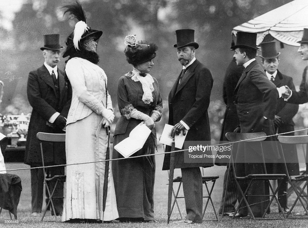 King George V, (1865 - 1936), who ascended the British throne in 1910, watches the parade of prizewinners at Richmond Horse Show.