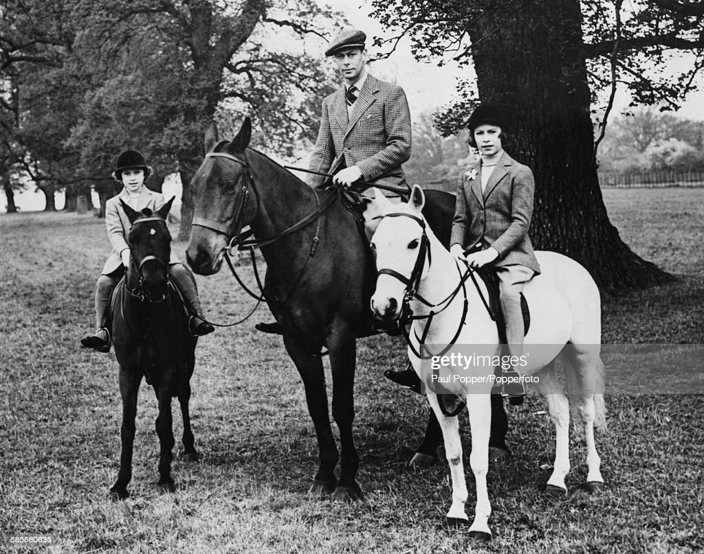 King George VI (1895-1952) and his daughters, Princesses Elizabeth (right) and Margaret (1930-2002) on horseback in the grounds of Windsor Great Park on Elizabeth's 12th birthday, England, April 2ist 1938.
