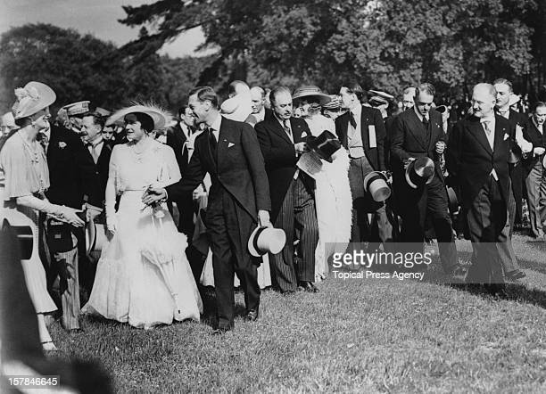 King George VI and Queen Elizabeth attend a garden party at the Château de Bagatelle in the Bois de Boulogne, during their State Visit to Paris,...