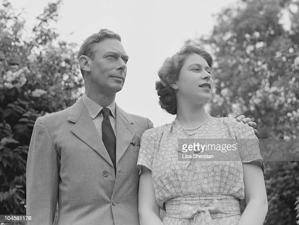 King George VI and Queen Elizabeth in the gardens at Windsor Castle England on July 8 1946