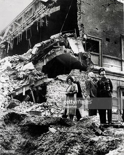 World War II London England King George VI and Queen Elizabeth inspect bomb damage to Baker Street Cinema after Nazi air raids over the capital