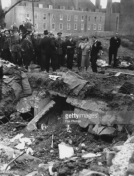 King George VI and Queen Elizabeth inspecting airraid damage at Dog Kennel Hill south London during the Blitz 10th September 1940