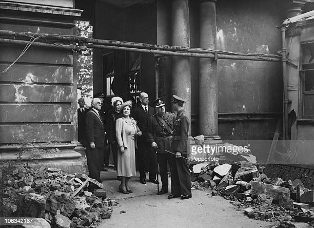 King George VI and Queen Elizabeth inspecting airraid damage at St Thomas' Hospital London during the Blitz September 1940