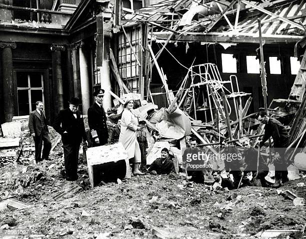 World War Two London England King George VI and Queen Elizabeth inspect bomb damage to Buckingham Palace after Nazi air raids over the capital with...