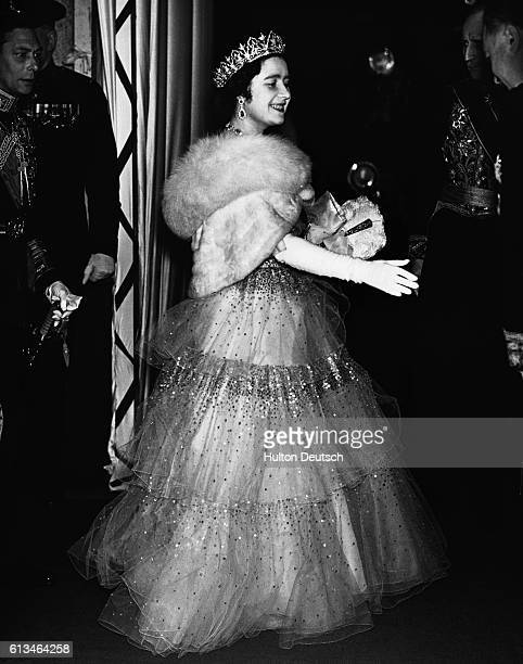 King George VI and Queen Elizabeth of England are welcomed to the French Embassy before going to a performance at the Royal Opera House in Covent...