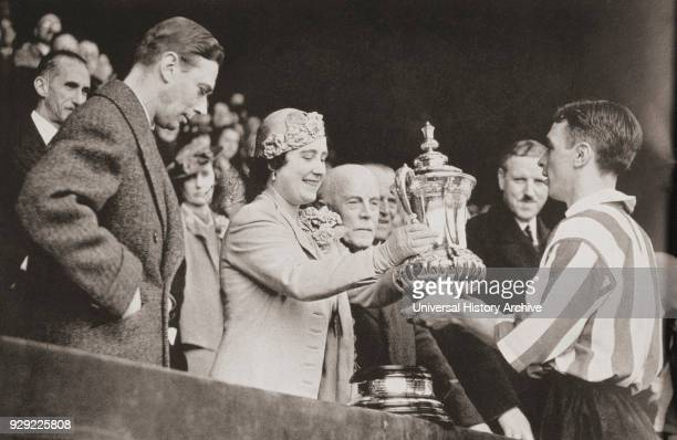 King George VI and Queen Elizabeth presenting the cup to Raich Carter the Sunderland captain after his team's victory at Wembley in 1937 From The...