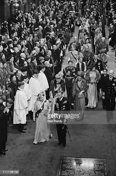 King George VI and Queen Elizabeth the Queen Mother make their way down the aisle of Westminster Abbey London at the wedding of Princess Elizabeth...