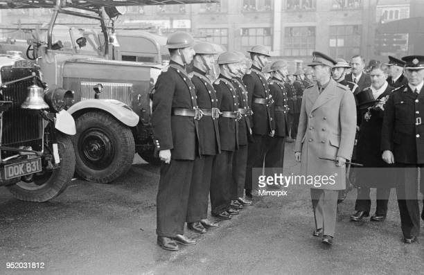 King George VI inspects firemen on his visit to Birmingham after a bombing raid in world War Two December 1940