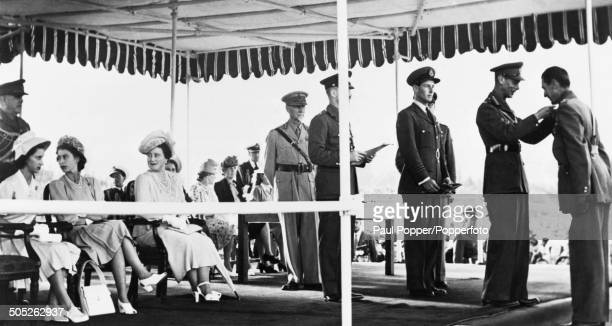 King George VI presenting awards at a military investiture in Pretoria during the royal tour of South Africa 1947 Seated on the left are Princess...