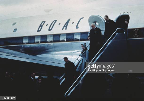King George VI Queen Elizabeth and Princess Margaret leave a BOAC royal aircraft at London Airport having bid farewell to Princess Elizabeth and...