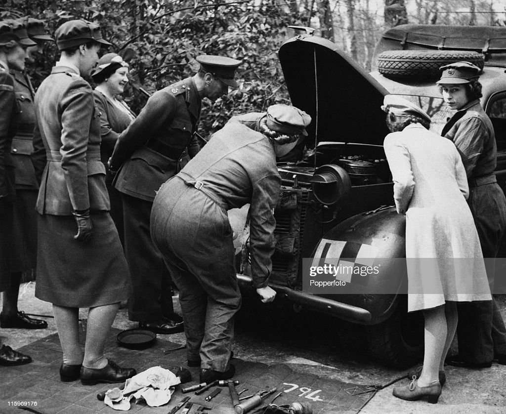 King George VI, Queen Elizabeth and Princess Margaret visit Princess Elizabeth, who is training as an ATS mechanic at a training centre in southern England, April 1945. At this stage she is a Second Subaltern of the ATS (Auxiliary Territorial Service).