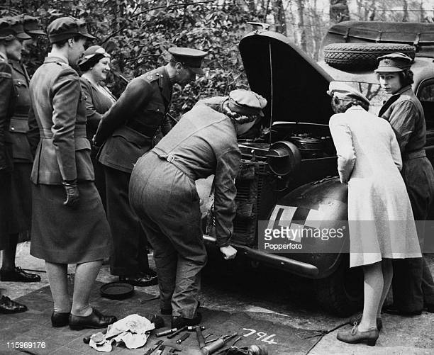 King George VI, Queen Elizabeth and Princess Margaret visit Princess Elizabeth, who is training as an ATS mechanic at a training centre in southern...