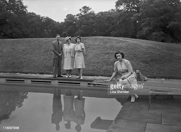 King George VI Queen Elizabeth Princess Elizabeth and Princess Margaret in the grounds of Windsor Castle in Windsor England on July 08 1946