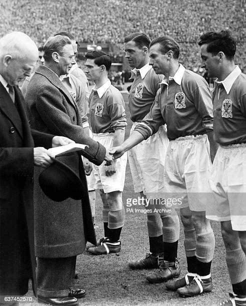HRH King George VI shakes hands with Blackpool's Stanley Matthews as Blackpool captain Harry Johnston introduces the king to his teammates before the...