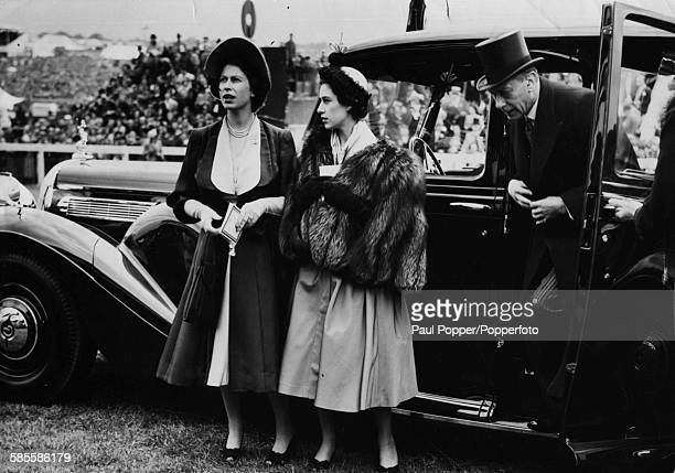 King George VI steps out of his car to join Princesses Elizabeth and Margaret for the Derby at Epsom racecourse in England May 27th 1950