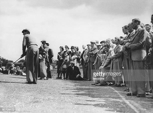 King George VI watches Belgian golfer Flory Van Donck on the 14th green during the Open Golf Championship at Muirfield Scotland 5th July 1948