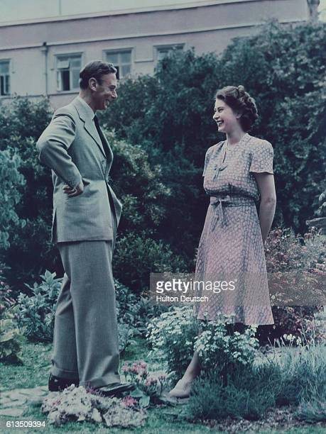 King George VI with his eldest daughter Princess Elizabeth in the garden at Windsor