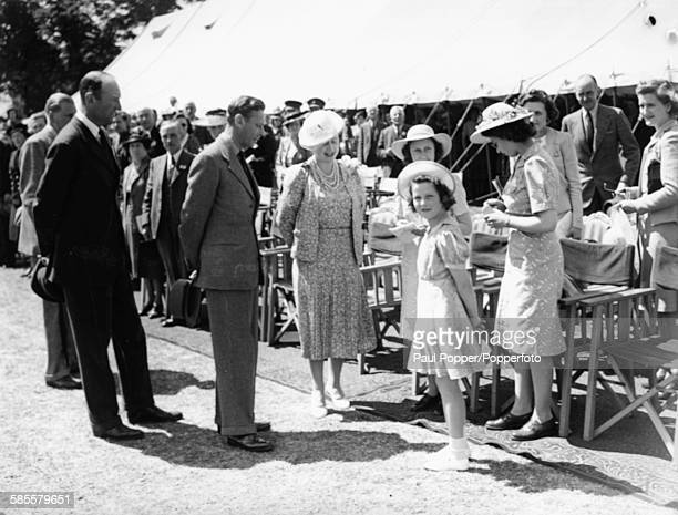 King George VI with Queen Elizabeth and Princesses Margaret Alexandra and Elizabeth at the Royal Windsor Horse Show England May 28th 1944