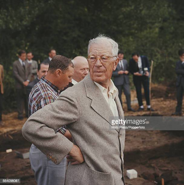 King Gustaf VI Adolf of Sweden pictured centre in his role as an amateur archaeologist stands beside excavations on an archeological dig near Rome...