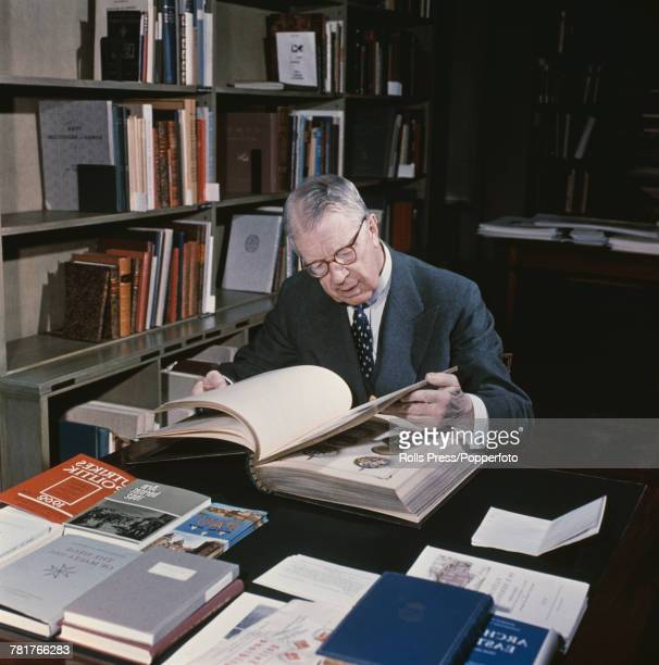 King Gustaf VI Adolf of Sweden pictured studying books in his library in Stockholm Sweden in 1969