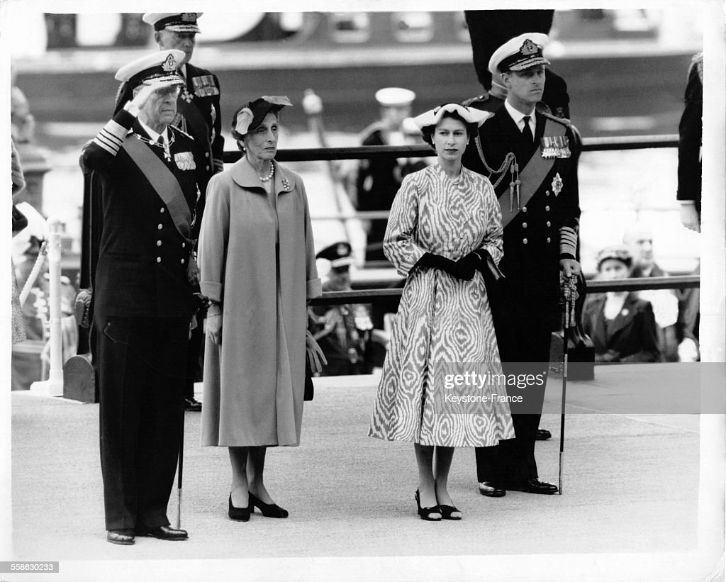 King Gustaf VI Adolf of Sweden salutes with queen Louise Mountbattent, queen Elizabeth II and Philip Mountbatten, Duke of Edinburgh on landing at Westminster pier on June 28, 1954, in London, United Kingdom.