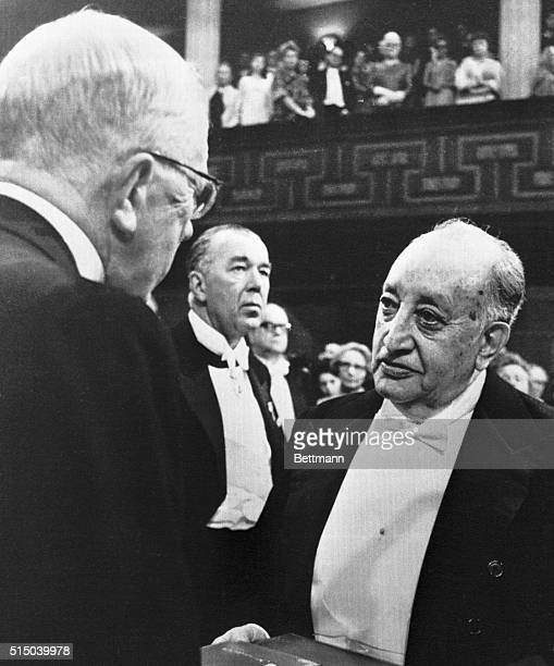 King Gustav Adolf of Sweden presents the Nobel Prize for Literature to Guatemala's Dr Miguel Angel Asturias during Nobel Prize Award Ceremony at the...