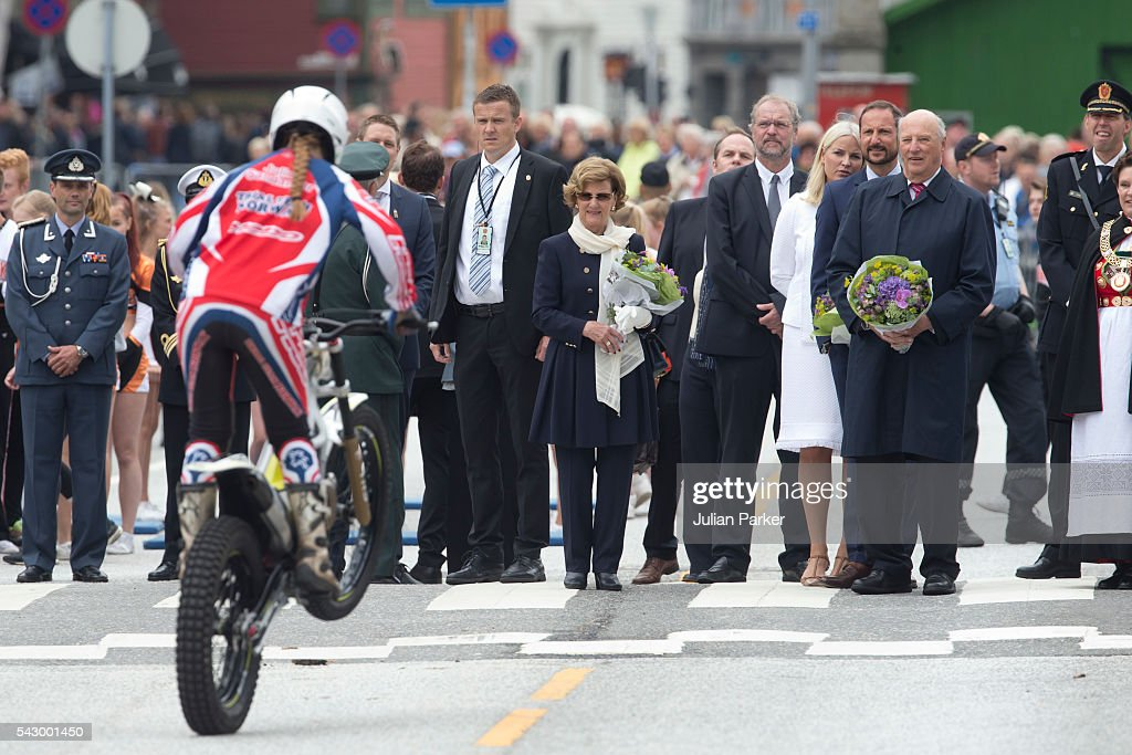 King Harald, and Queen Sonja of Norway,Crown Princess Mette-Marit, and Crown Prince Haakon of Norway, watch a motorcycle stunt display, on a visit to Bergen, during the King and Queen of Norway's Silver Jubilee Tour, on June 25, 2016 in Bergen, Norway.