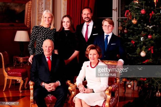 King Harald, Crown Princess Mette-Marit, Princess Ingrid Alexandra, Crown Prince Haakon, Queen Sonja and Prince Sverre Magnus pose for a picture next...