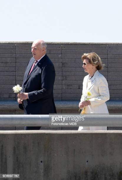 King Harald of Norway and Queen Sonjia of Norway prepare to throw flowers into the water as they visit the Parque de la Memoria honoring the vicitims...