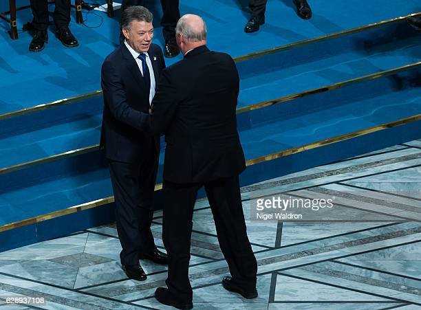 King Harald of Norway congratulates the Nobel Peace Prize winner President Juan Manuel Santos of Colombia, during the Nobel Peace Prize Ceremony at...