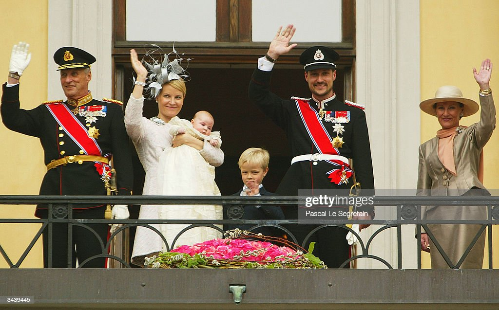 King Harald of Norway, Crown Princess Mette-Marit holding Princess Ingrid Alexandra, her son Marius Hoiby, Crown Prince Haakon and Queen Sonja of Norway wave from the balcony of the royal palace after the christening of Princess Ingrid Alexandra - daughter of Crown Prince Haakon and Crown Princess Mette-Marit on April 17, 2004 in Oslo, Norway. The Princess was born on January 21, 2004 and is second in line to the throne.