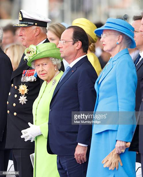 King Harald of Norway Queen Elizabeth II French President Francois Hollande and Queen Margrethe of Denmark attend the International Ceremony at Sword...
