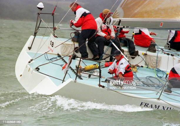 King Harald of Norway works the leward spinnacker winch as his yacht Fram XIV rounds one of the marks in the first race of the Champagne Mumm...