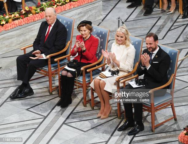 King Harald Queen Sonja Crown Princess MetteMarit and Crown Prince Haakon attend the Nobel Peace Prize ceremony 2019 at Oslo City Town Hall on...