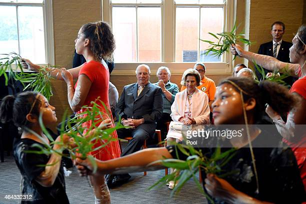 King Harald V and Queen Sonja of Norway watch on as an Indigenous dance troupe performs during a welcoming ceremony at the National Centre for...