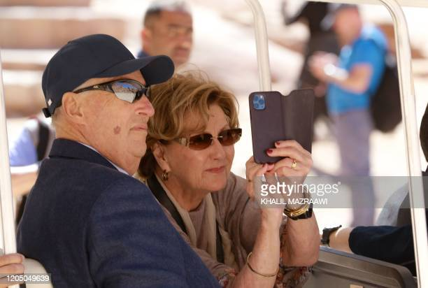 King Harald V of Norway and his wife Queen Sonja of Norway visit Jordan's archaeological city of Petra south of the capital Amman on March 4 2020