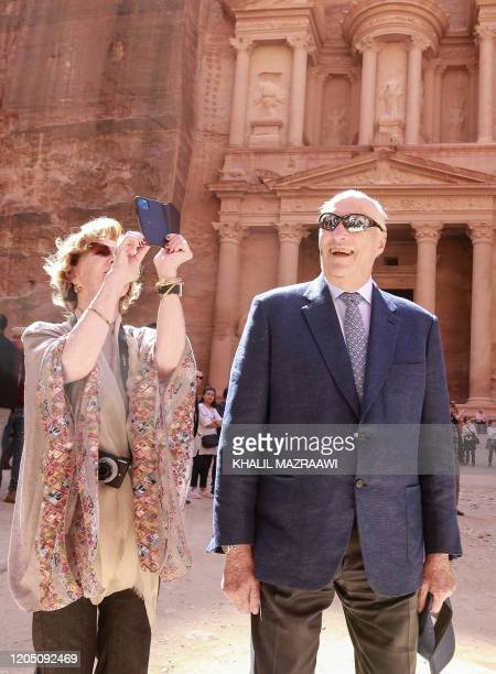 King Harald V of Norway and his wife Queen Sonja stand in front of the Khazneh structure during their visit to Jordan's archaeological city of Petra...