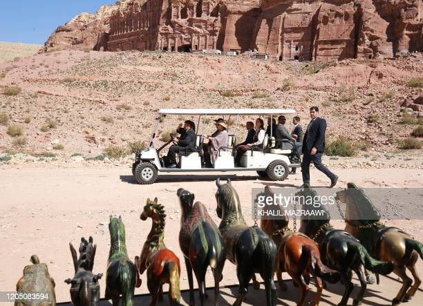 King Harald V of Norway and his wife Queen Sonja take a cart tour during their visit of Jordan's archaeological city of Petra south of the capital...